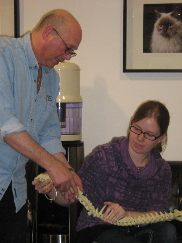 Dr. Goldberg and Jen demonstrating an adjustment on a dog's spine.